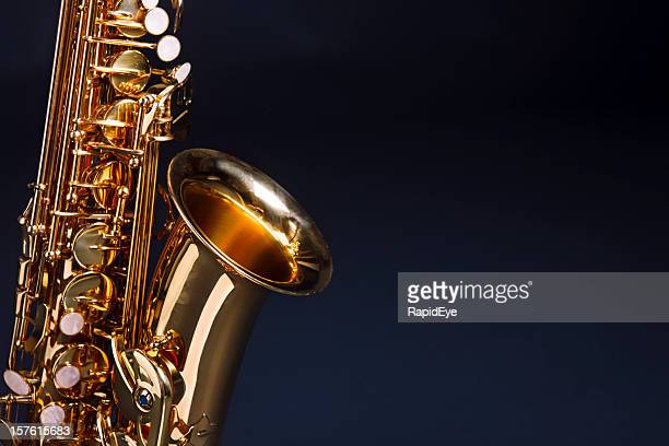 Making beautiful music: golden saxophone against deep blue