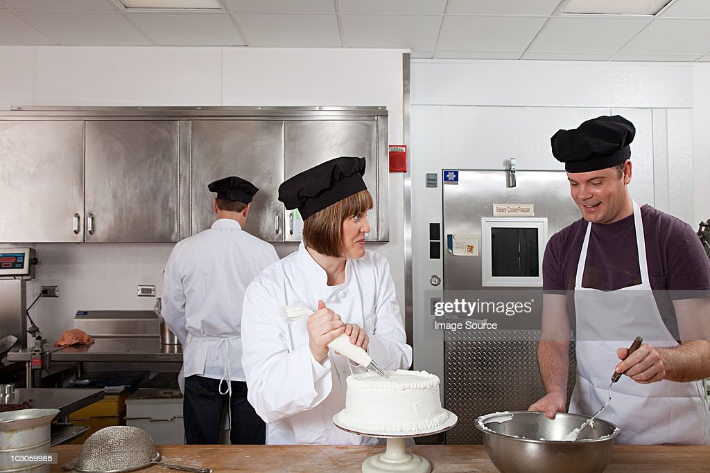 Making cake in commercial kitchen : Stock Photo