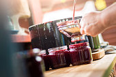 Making Cherry Jam, filling jars