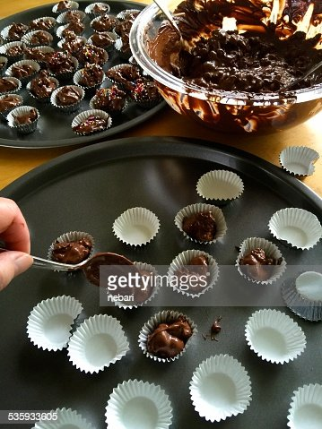 Making chocolate candy with nuts : Stock Photo