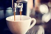 Espresso machine making fresh cup of coffee