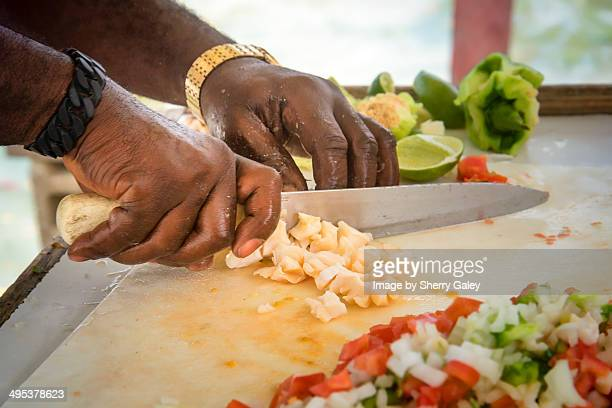 Making conch salad on the street