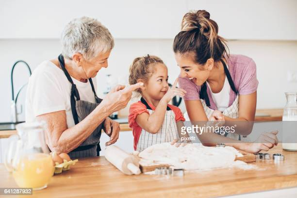 Making cookies with mom and grandma is so much fun