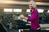 Shot of a mature woman exercising on a treadmill at the gym