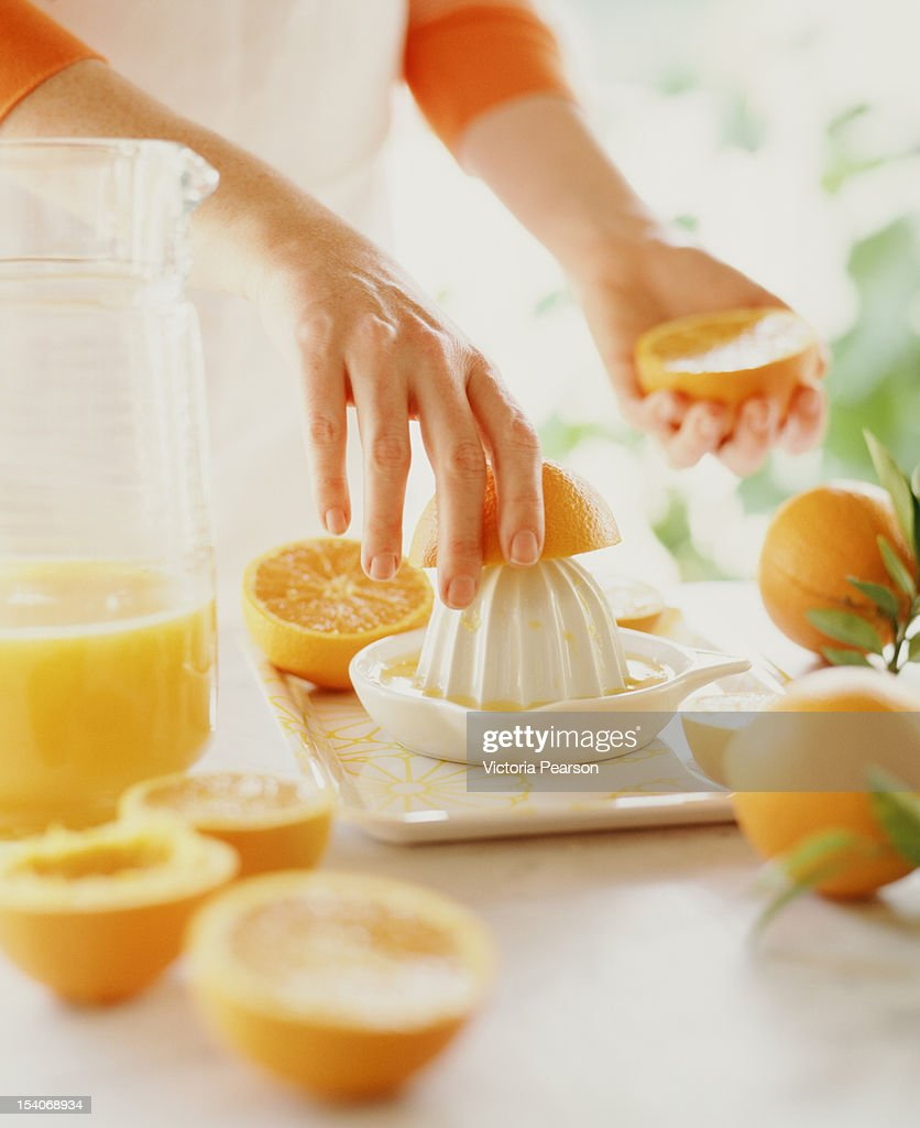 Making freshly-squeezed orange juice. : Stock Photo