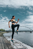 Young sportswoman exercising outdoors