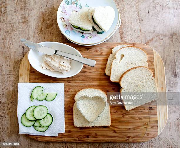 Making heart shaped cucumber sandwiches.