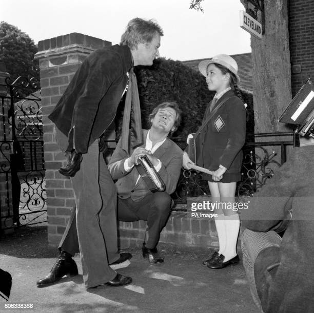 Making her first appearance before the cameras seven year old Deborah Moore gets expert advice from Hollywood actor Tony Curtis and her father Roger...