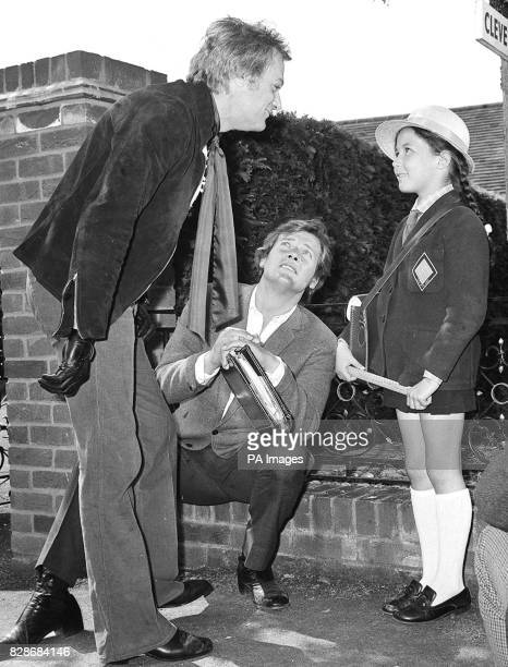 Making her first appearance before the cameras sevenyearold Deborah gets expert advice from Tony Curtis and her father Roger Moore They were on set...