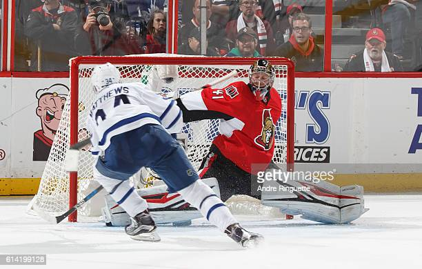 Making his NHL debut Auston Matthews of the Toronto Maple Leafs scores his fourth goal of the game against Craig Anderson the Ottawa Senators at...