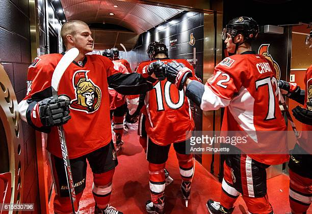 Making his NHl debut Thomas Chabot of the Ottawa Senators highfives teammate Mark Borowiecki in the players' tunnel before warmup prior to a game...