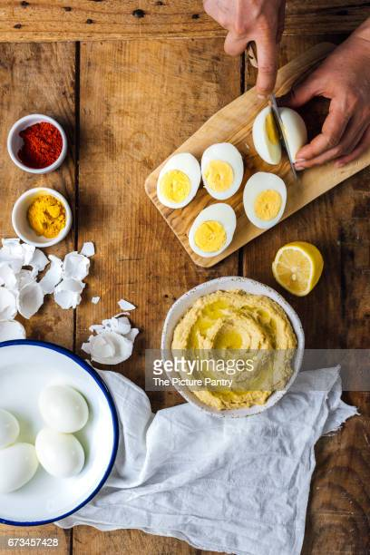 Making hummus deviled eggs