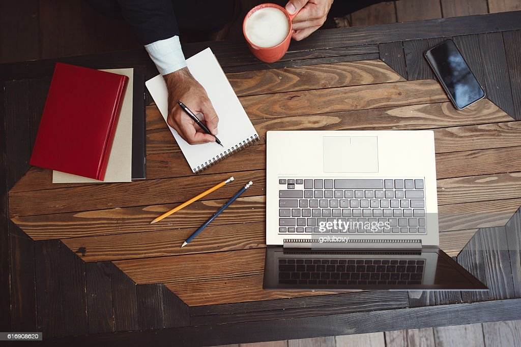 Making list of career and life wishes : Stock Photo