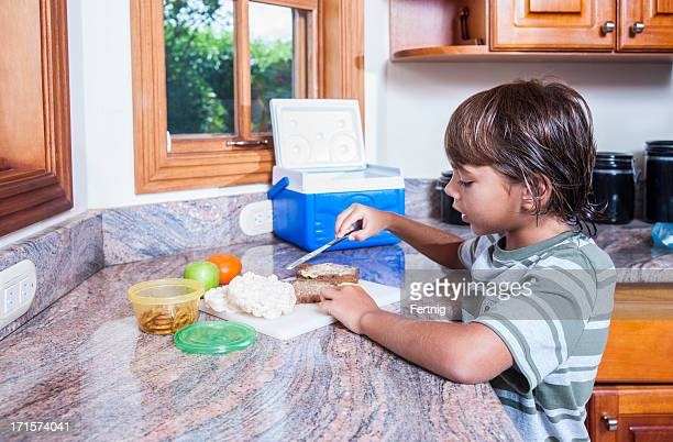 Making my school lunch in the kitchen .