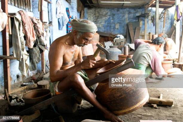 Making of copper utensils in vessel manufacturing industry in Anupparpalayam metal town, Tirupur, Tamil Nadu, India