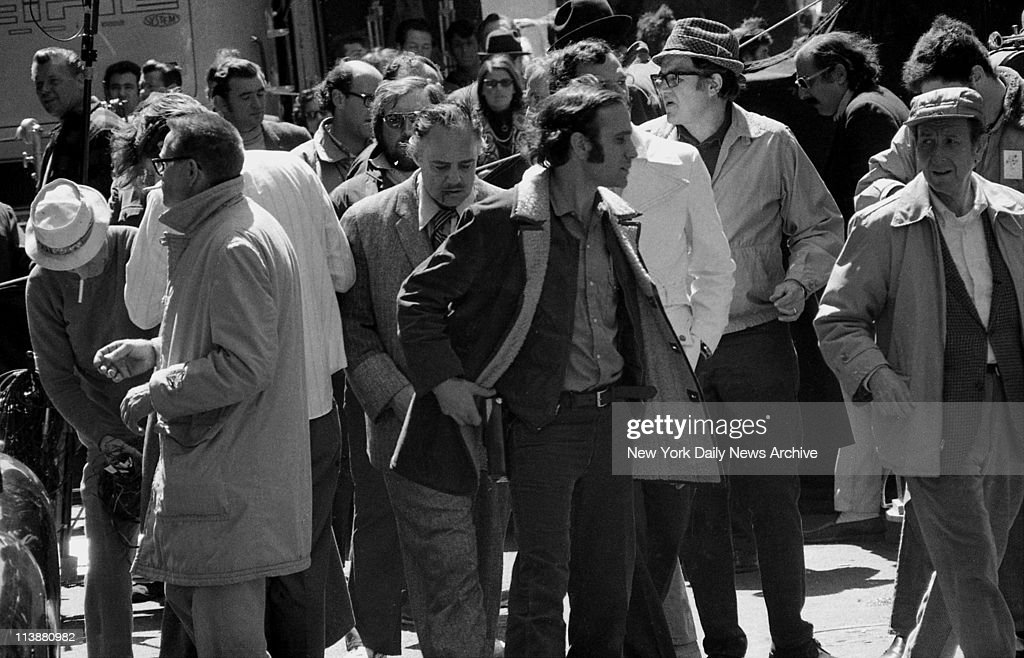 Making of movie The Godfather on Mott Street in Manhattan Simulated blood dripping from his mouth Marlon Brando is surrounded by movie people after...