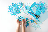 Making of snowflakes from paper.  A traditional Christmas arts and crafts project