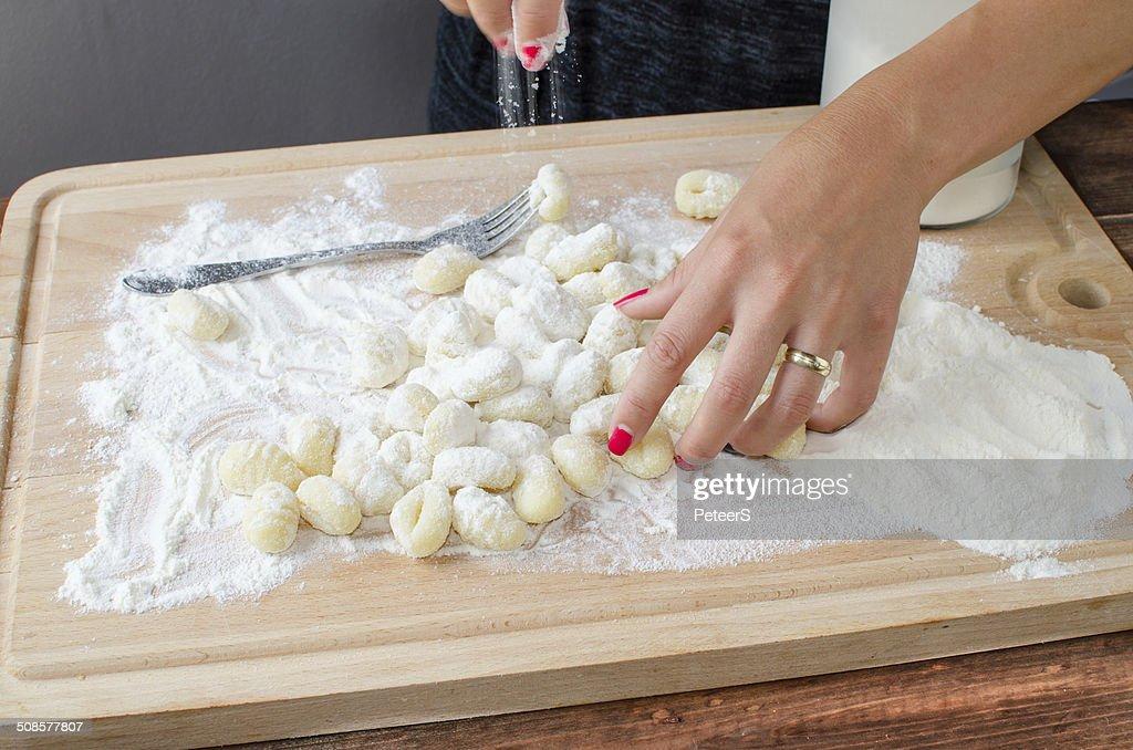Making pasta gnocchi : Stock Photo