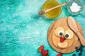 Making perfect pancakes for kids on Shrove Tuesday, copy space border background