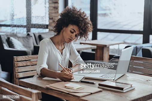 Making some notes. : Stock Photo