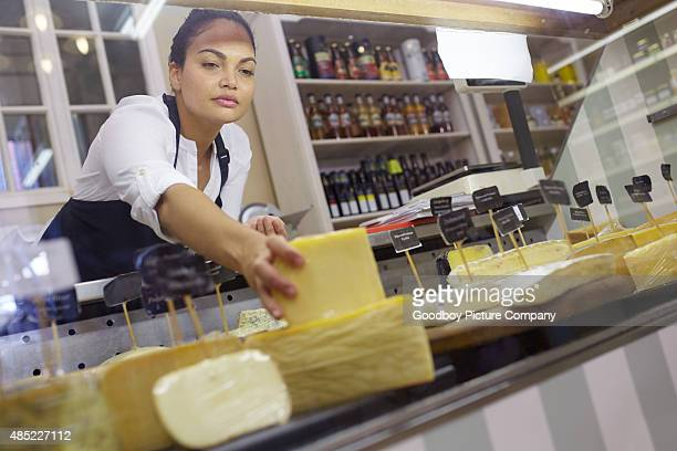 Making sure her cheese display is perfect