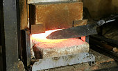 Making the knife out of metal at the forge. Heating of metal billets in the furnace