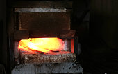 Making the sword out of metal at the forge. Heating of metal billets in the furnace