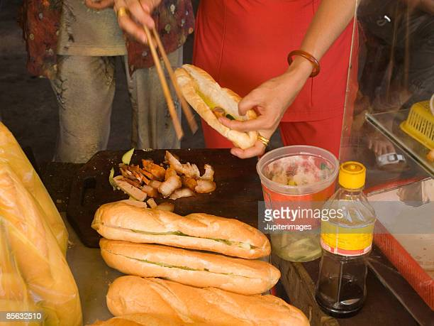 Making Vietnamese sandwiches or banh mi, Vietnam