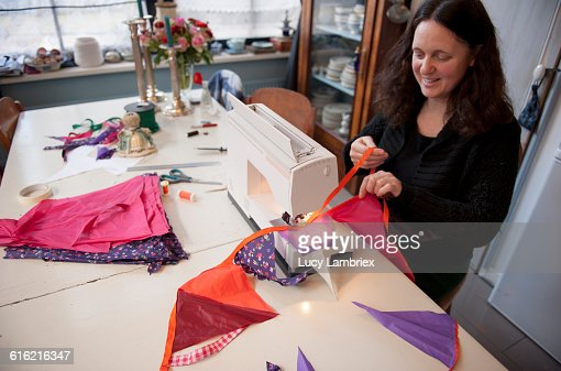Making weather proof bunting out of old umbrellas : Stock Photo