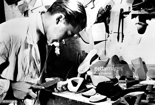 Making wooden shoe soles Germanoccupied Paris February 1941 Like most things leather was scarce during the occupation