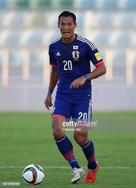 Makino Tomoaki of Japan controls the ball during the 2018 FIFA World Cup Asian Group E qualifying match between Syria and Japan at Seeb Stadium on...