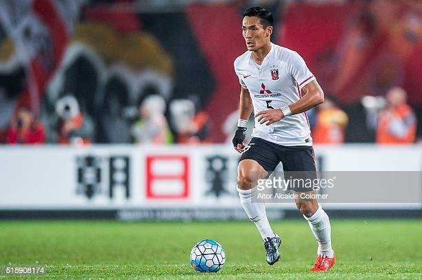 Makino Tomoaki of Urawa Red Diamonds in action during the AFC CHampions League match between Guangzhou Evergrande and Urawa Red Diamonds on March 16...