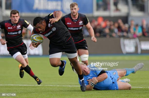 Mako Vunipola of Saracens avoids Petrus Du Plessis of London Irish to score their first try during the Aviva Premiership match between Saracens and...