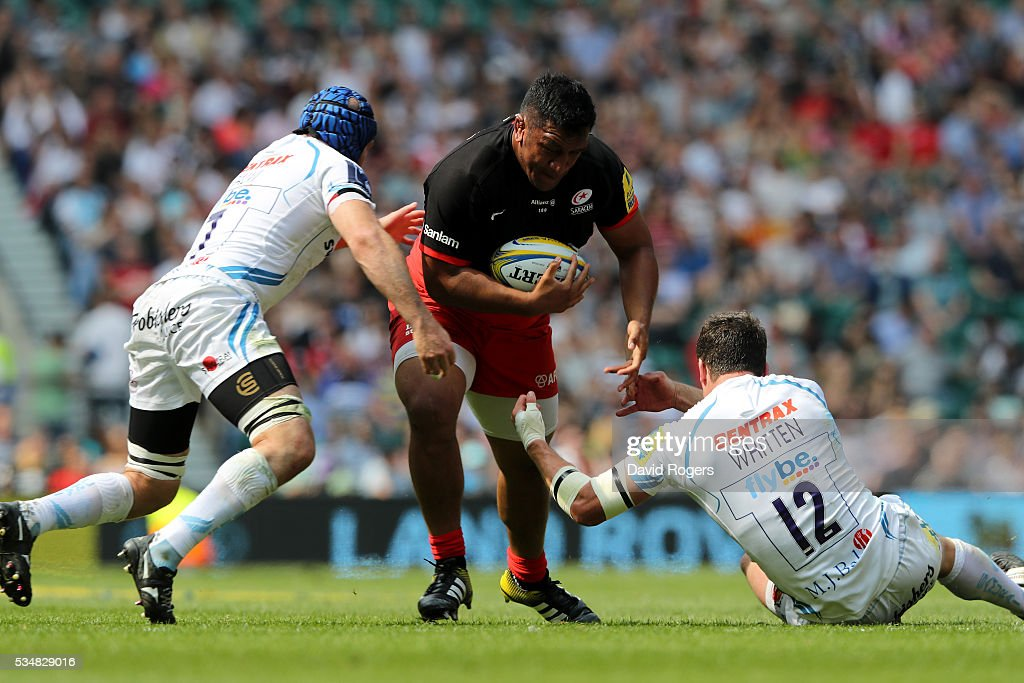 <a gi-track='captionPersonalityLinkClicked' href=/galleries/search?phrase=Mako+Vunipola&family=editorial&specificpeople=4948128 ng-click='$event.stopPropagation()'>Mako Vunipola</a> of Saracens is tackled by <a gi-track='captionPersonalityLinkClicked' href=/galleries/search?phrase=Julian+Salvi&family=editorial&specificpeople=663309 ng-click='$event.stopPropagation()'>Julian Salvi</a> and Ian Whitten of Exeter Chiefs during the Aviva Premiership final match between Saracens and Exeter Chiefs at Twickenham Stadium on May 28, 2016 in London, England.