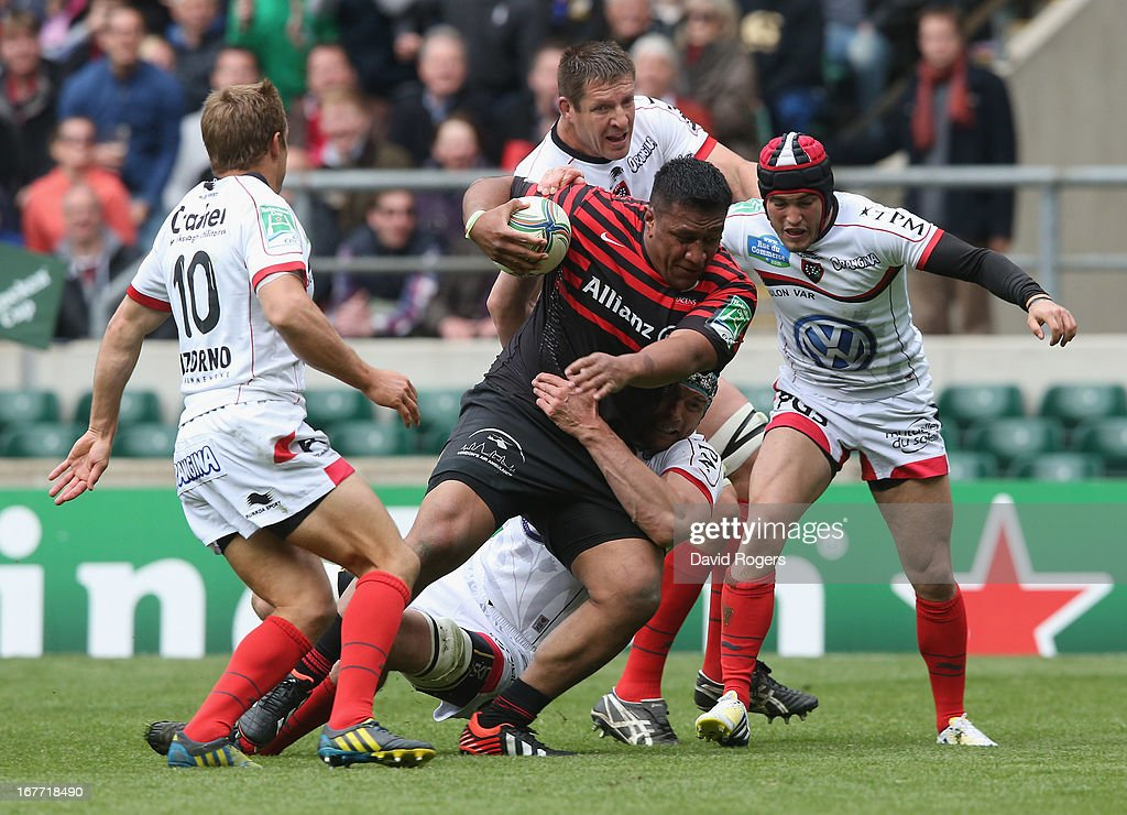 Mako Vunipola of Saracens is tackled during the Heineken Cup semi final match between Saracens and Toulon at Twickenham Stadium on April 28, 2013 in London, United Kingdom.