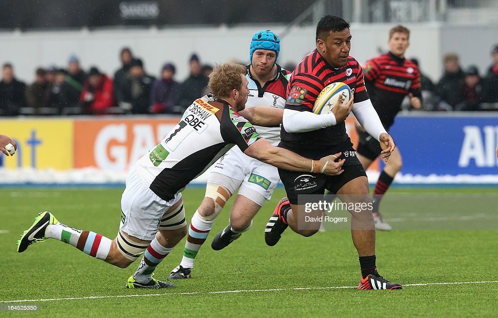 Mako Vunipola of Saracens moves past <a gi-track='captionPersonalityLinkClicked' href=/galleries/search?phrase=Chris+Robshaw&family=editorial&specificpeople=2375303 ng-click='$event.stopPropagation()'>Chris Robshaw</a> during the Aviva Premiership match between Saracens and Harlequins at Allianz Park on March 24, 2013 in Barnet, England.