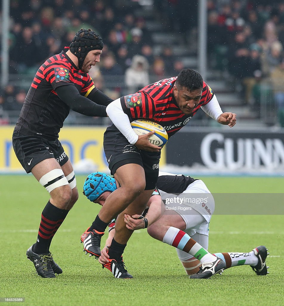 Mako Vunipola of Saracens moves past Joe Gray during the Aviva Premiership match between Saracens and Harlequins at Allianz Park on March 24, 2013 in Barnet, England.