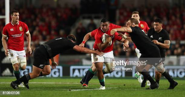 Mako Vunipola of the Lions is tackled by Joe Moody and Owen Franks of the All Blacks during the third test match between the New Zealand All Blacks...
