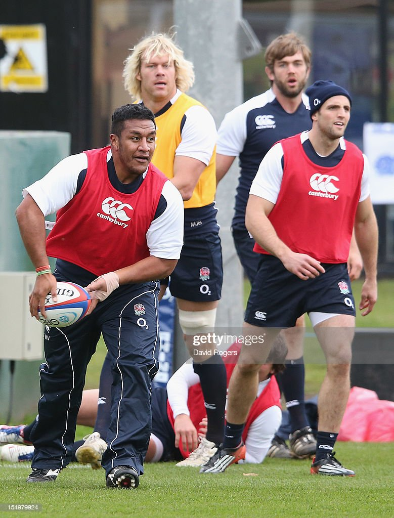 Mako Vunipola passes the ball during the England training session held at St Georges Park on October 29, 2012 in Burton-upon-Trent, England.