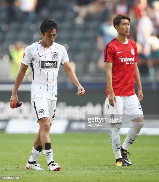 Makoto Hasebe and Daichi Kamada of Frankfurt react after the Bundesliga match between Eintracht Frankfurt and VfL Wolfsburg at CommerzbankArena on...