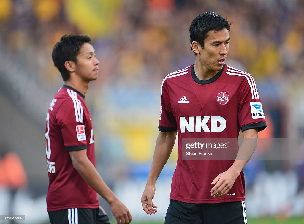 <a gi-track='captionPersonalityLinkClicked' href=/galleries/search?phrase=Makoto+Hasebe&family=editorial&specificpeople=876998 ng-click='$event.stopPropagation()'>Makoto Hasebe</a> and <a gi-track='captionPersonalityLinkClicked' href=/galleries/search?phrase=Hiroshi+Kiyotake&family=editorial&specificpeople=7645519 ng-click='$event.stopPropagation()'>Hiroshi Kiyotake</a> of Nuernberg ponder during the Bundesliga match between Eintracht Braunschweig and 1. FC Nuernberg at Eintracht Stadion on September 15, 2013 in Braunschweig, Germany.