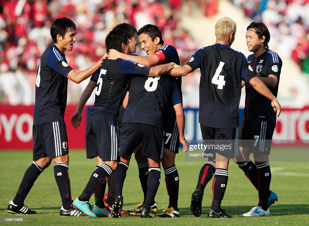 Makoto Hasebe congratulates Hiroshi Kiyotake of Japan after scoring the first goal during the FIFA World Cup Asian qualifier match between Oman and Japan at Sultan Qaboos Sports Complex on November 14, 2012 in Muscat, Oman.