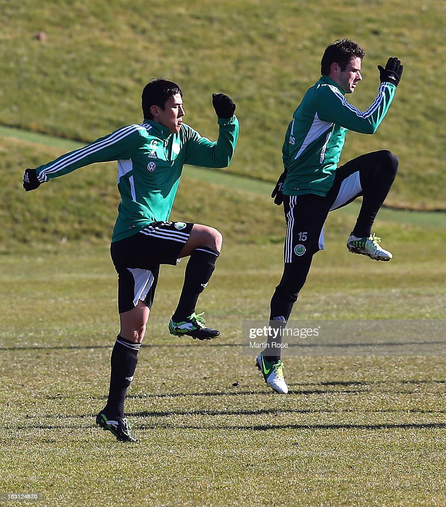 Makoto Hasebe (L) jumps during a VfL Wolfsburg training session on March 5, 2013 in Wolfsburg, Germany.