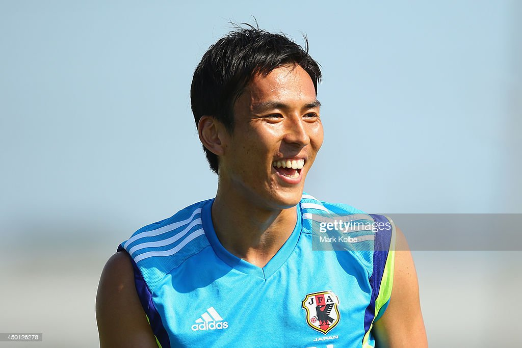 Makoto Hasebe laughs during a Japan training session at North Greenwood Recreation & Aquatic Complex on June 5, 2014 in Clearwater, Florida.