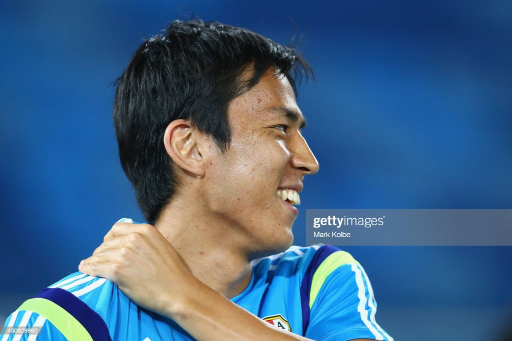 Makoto Hasebe laughs during a Japan training session at the Dunas Arena in Natal on June 18, 2014 in Natal, Rio Grande do Norte.