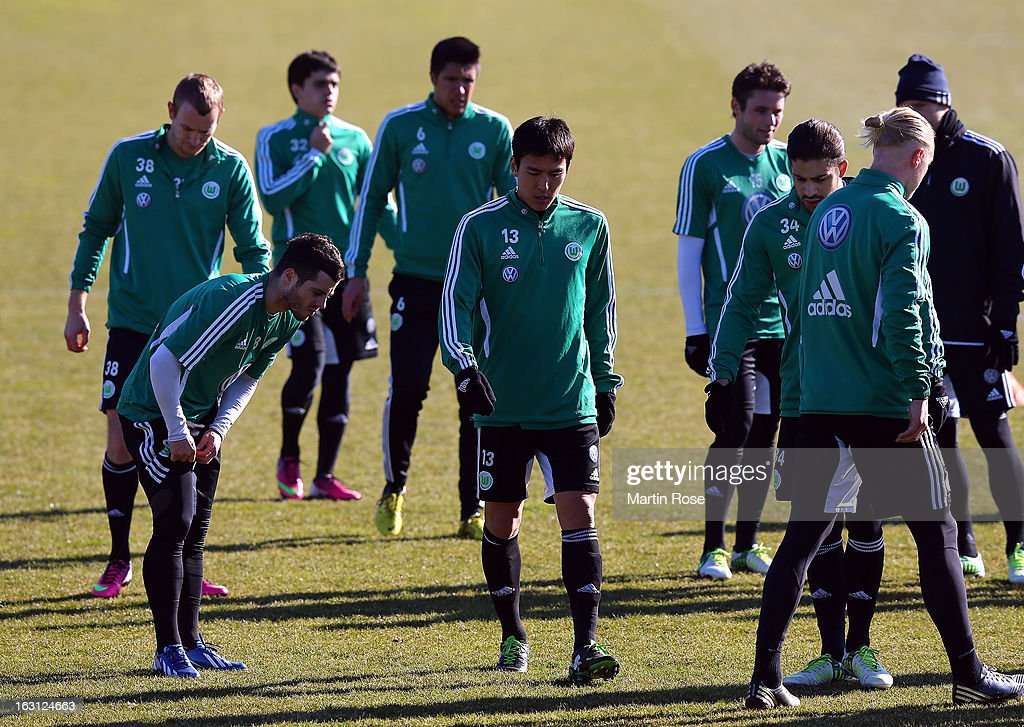 Makoto Hasebe (#13) looks on during a VfL Wolfsburg training session on March 5, 2013 in Wolfsburg, Germany.