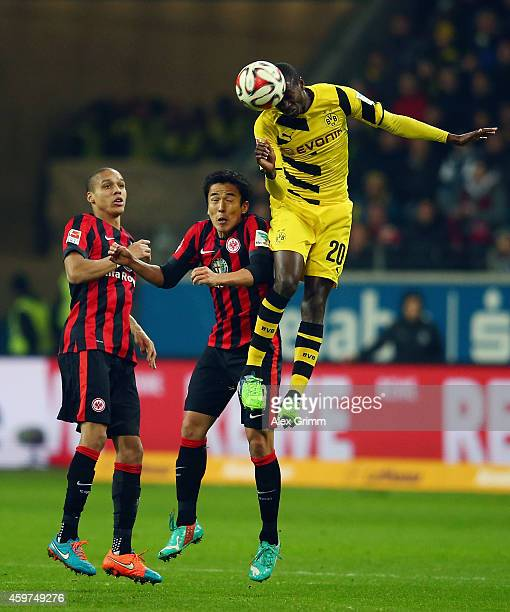 Makoto Hasebe of Eintracht Frankfurt challenges Adrian Ramos of Borussia Dortmund during the Bundesliga match between Eintracht Frankfurt and...