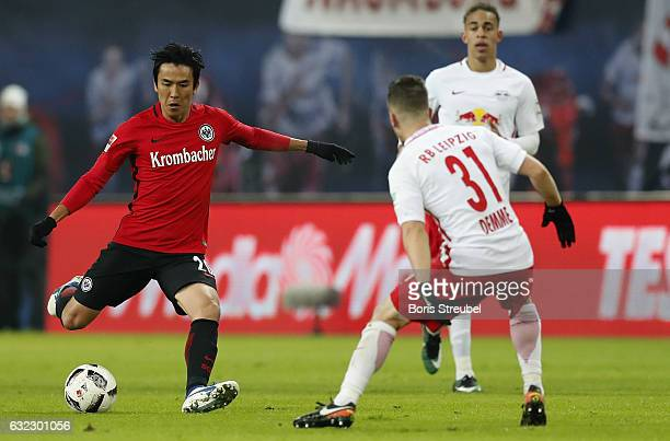 Makoto Hasebe of Eintracht Frankfurt is challenged by Diego Demme of RB Leipzig during the Bundesliga match between RB Leipzig and Eintracht...