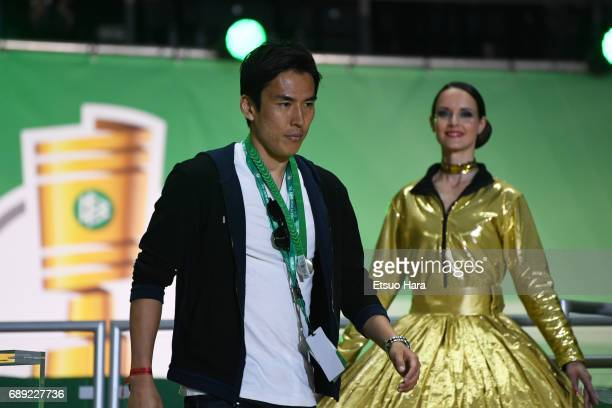 Makoto Hasebe of Eintracht Frankfurt is seen at the medal ceremony after the DFB Cup Final match between Eintracht Frankfurt and Borussia Dortmund at...