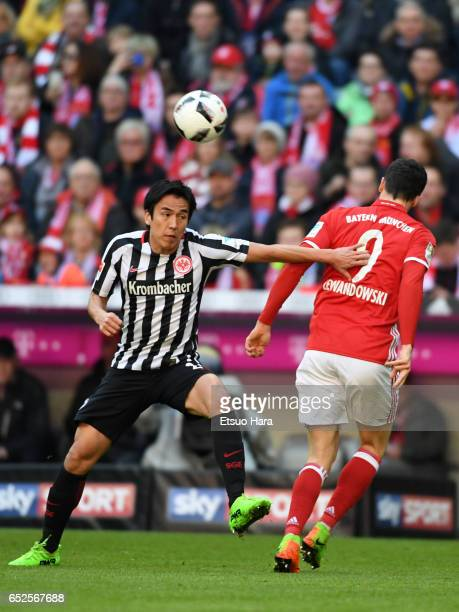 Makoto Hasebe of Frankfurt and Robert Lewandowski of Bayern compete for the ball during the Bundesliga match between Bayern Muenchen and Eintracht...